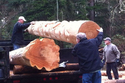 Totem Poles carved by Robert Canterbury are loaded at Camano Island for transport to Quilcene